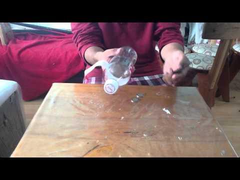 Cómo meter una moneda en una botella - Truco de magia sorprendente